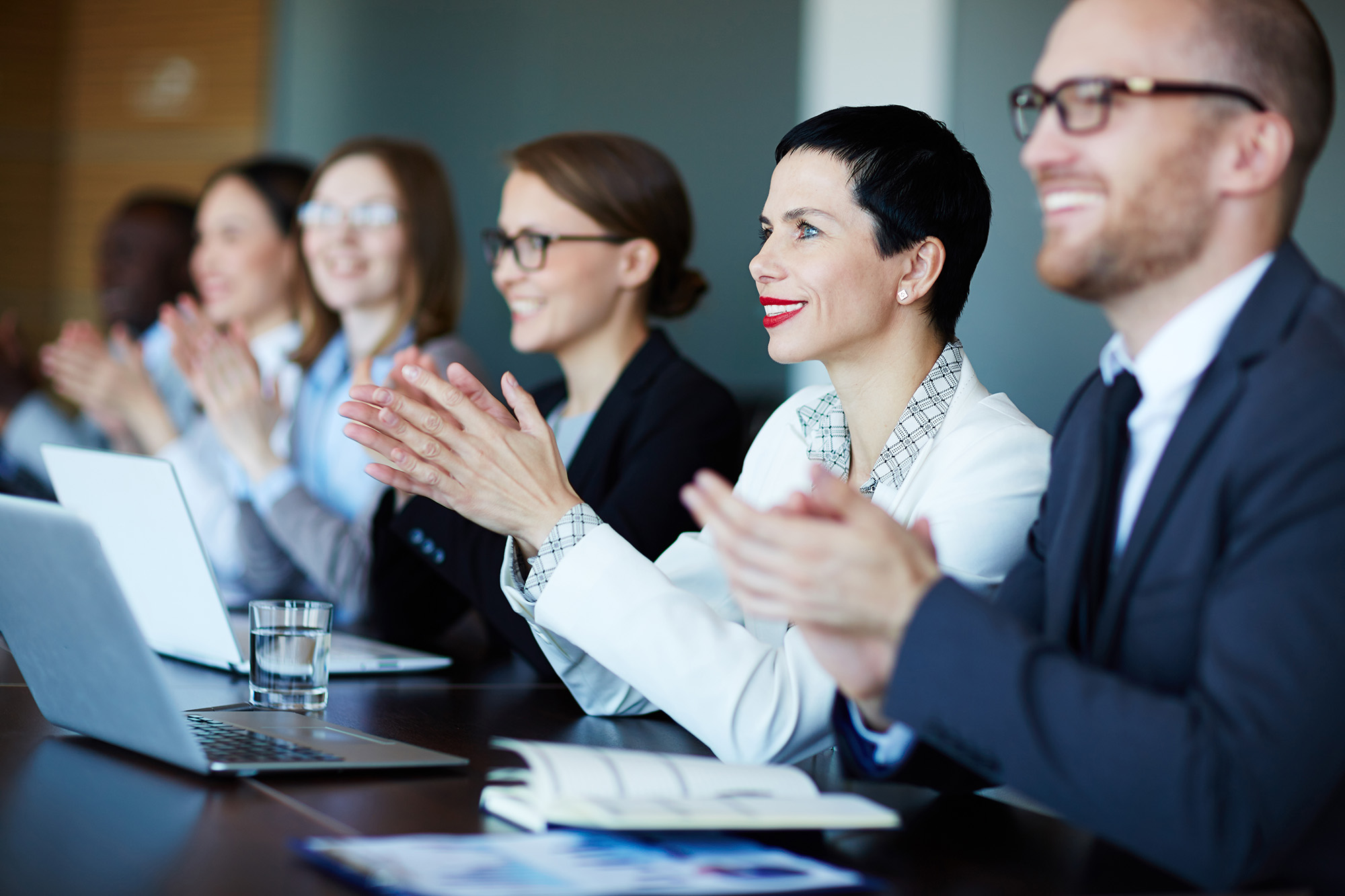 co-workers clapping at presentation